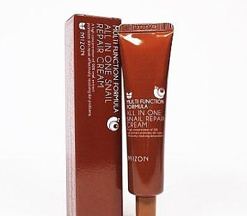 Reparierende und feuchtigkeitsspendende Gesichtscreme gegen Aknenarben und Hautunreinheiten mit 92% Schneckenextrakt - Mizon All in One Snail Repair Cream (Mini)